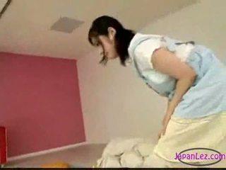 Asian girl masturbating while licking ...