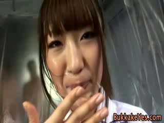Asian bukkake fetish slut facially cum drenched
