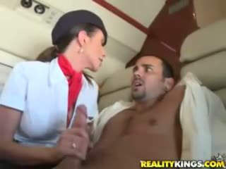 Hot flight attendents Ariella Ferrera and Aimee Addison give in flight blowjob