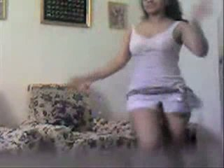 Dancing brunette masturbating on the couch Video