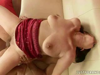 Hot grandma enjoys huge cock in her pu...