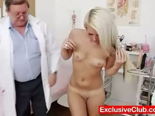Old doctor checks young blonde girl Ve...
