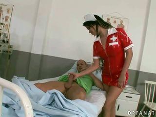 Naughty nurse riding two cocks