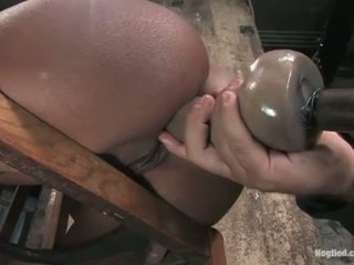 Monique tied to a chair and gets ass fucked with dildo