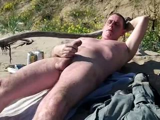 Long slow cock show on public beach