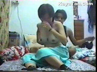 Malay číňan pár pohlaví pod skrytý vačka