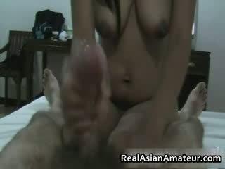 Hairy pussy asian hottie handjob