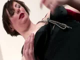 Mature lady in suspenders fucks and sucks