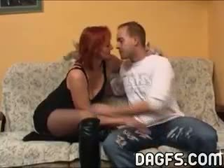 Red-haired And Aged Mom Warms Up A Young Man For Sex Action