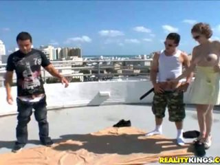 Foursome handjob on a roof, somewhere in Miami