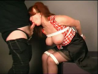 Busty redhead submissively deepthroats Video