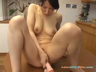 Asian Milf enjoys dildoing herself on her dining room table