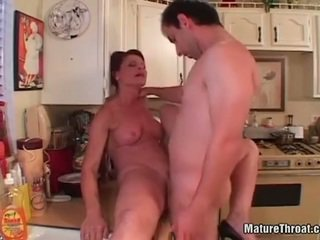 Hot mature getting her pussy licked in kitchen.