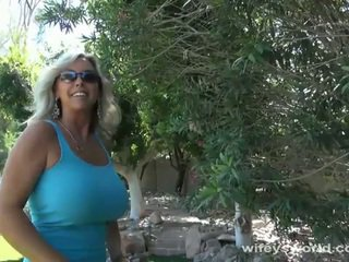 Big titted blonde milf blows outdoors