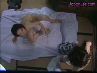 oriental Girl With Hairy Armpit Licking Pussy Fucking With Strap on On The Bed