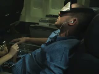 Amazing stewardess sucking sleeping passenger
