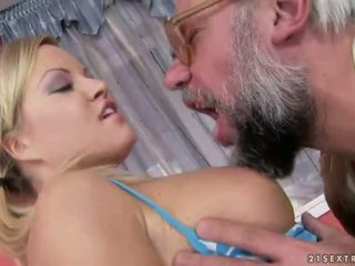 Young blonde enjoying sex with grandpa