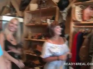 Mature lady paid to show off assets in a store