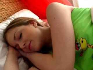Sleepy blonde chick masturbates in the bedroom