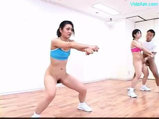 Guy stopping the time on the aerobic class stripping girls o