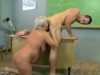 Mature teacher fucking with her student