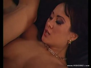 Asia Carrera gets a pop shot on her hairy pussy