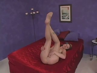 Delicious chick rubbing her hungry twat