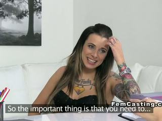 Tattooed amateur takes strap on toy on casting