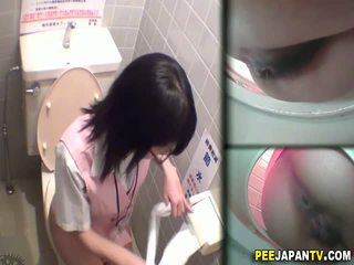 Asian slut pees in toilet