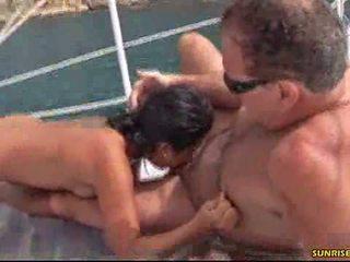Older guy enjoys sex on a boat in the ocean