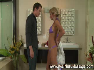 Busty blonde masseuse sucks on cock