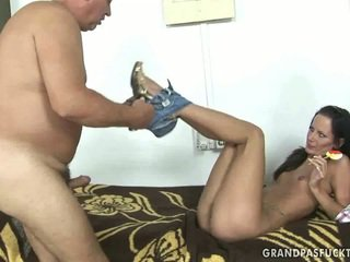 Young brunette riding old cock
