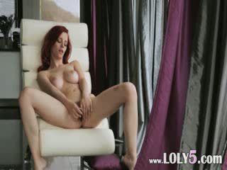 Red head enjoy new Dildo on the armchair