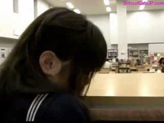 Schoolgirl getting her pussy rubbed at the library