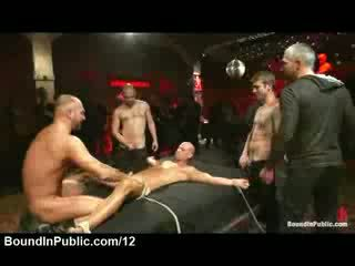 Bound gay spitted and fucked at public party