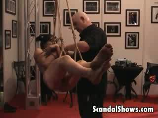 Super sexy tattooed brunette slut poses tied up at live strip show