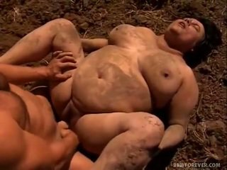 Farmer stretches mud filled beleibt