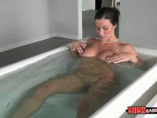 Hot MILF caught masturbating in the tub