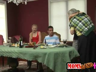 MILF Stroks a Young Cock Under the Tab...